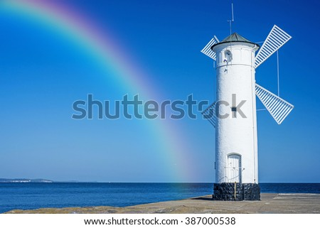 Swinoujscie, town's landmark with rainbow  - stock photo