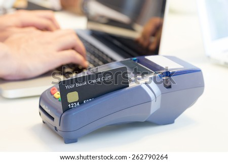 Swiping Credit Card In Store - stock photo