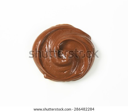 swirl of chocolate spread on white background - stock photo