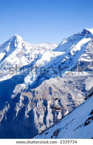 Swiss Alps behind the tram that goes to the Schilthorn in Switzerland - stock photo