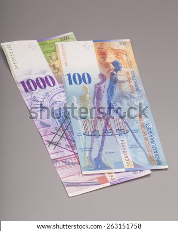 Swiss 1000 and 100 Franc notes isolated on gray - stock photo