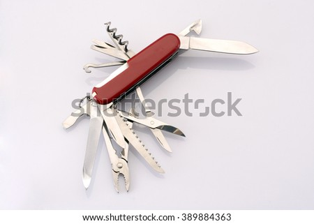 Swiss army knife against white background