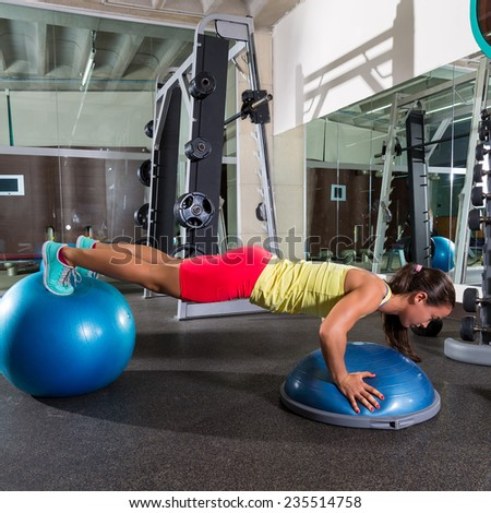 swiss ball bosu push up woman blue fitball workout at gym - stock photo