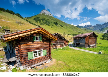 Swiss Chalet In The Mountains of The Alps In Switzerland