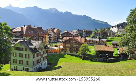 Swiss chalets in Wengen, Alps - stock photo