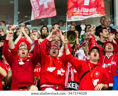 Swiss  fans  during 2014 IIHF World Ice Hockey Championship match at Minsk Arena on May  2014 in Minsk, Belarus. - stock photo
