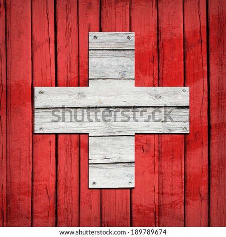 Swiss flag painted on wooden boards. Grunge style