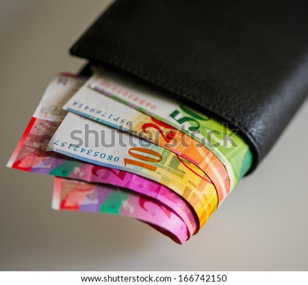 Swiss Franc advantages fifty, ten, twenty in your wallet on a light background - stock photo