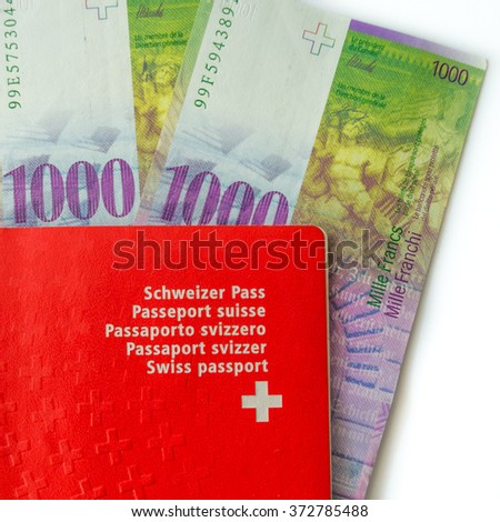 Swiss franc banknote in passport on white background CHF 1000  dignity. - stock photo