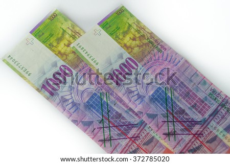 Swiss franc banknote on white background CHF 1000  dignity. Selective focus. - stock photo