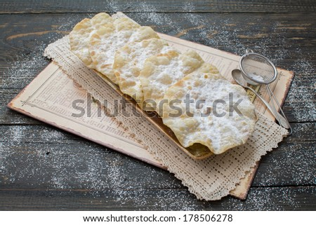 Swiss funnel cakes on a shabby vintage table - stock photo