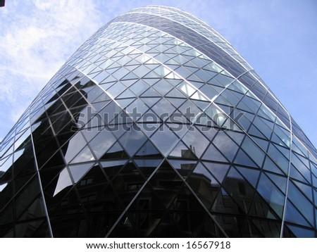 Swiss Re also known as the Gherkin with fragmented reflection London England UK - stock photo
