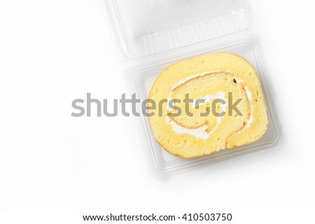 swiss roll in plastic box on white background