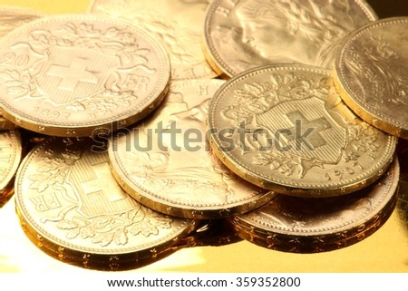swiss vreneli gold coins on golden background
