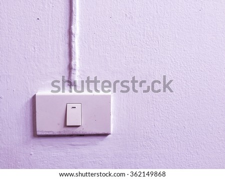 Switch on wall in purple tone