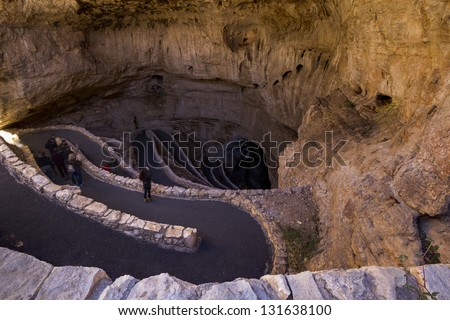 Switchback footpath winds into natural opening of Carlsbad Caverns. - stock photo