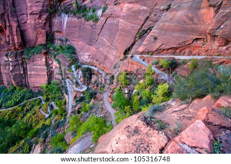 Switchbacks of the Angels Landing Trail wind down the walls of Zion Canyon in Utah - stock photo