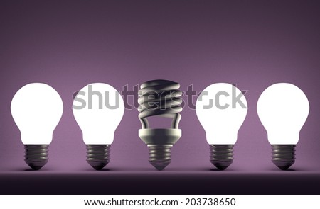 Switched off fluorescent light bulb in row of glowing incandescent ones on violet textured background