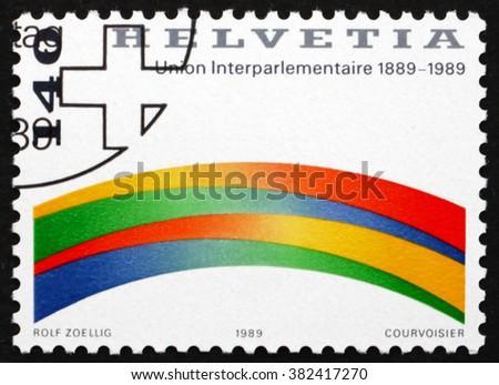 SWITZERLAND - CIRCA 1989: a stamp printed in Switzerland dedicated to Centenary of the Interparliamentary Union, circa 1989 - stock photo