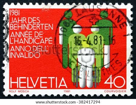 SWITZERLAND - CIRCA 1981: a stamp printed in Switzerland dedicated to International Year of Disabled, circa 1981 - stock photo