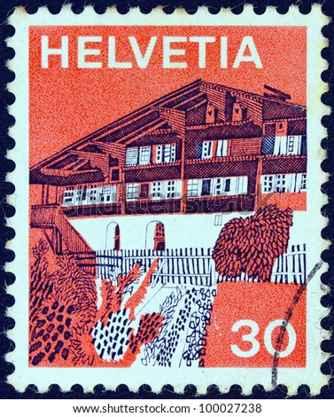 """SWITZERLAND - CIRCA 1973: A stamp printed in Switzerland from the """"Landscapes """" issue shows Erlenbach in Simmental (Bern), circa 1973. - stock photo"""