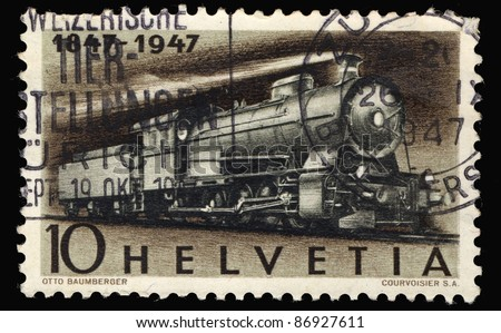 SWITZERLAND - CIRCA 1947: A stamp printed in Switzerland shows image of a Steam Freight Locomotive, circa 1947