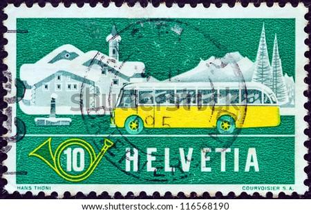 SWITZERLAND - CIRCA 1953: A stamp printed in Switzerland shows Mail Alpine Postal Coach and Winter Landscape, circa 1953. - stock photo