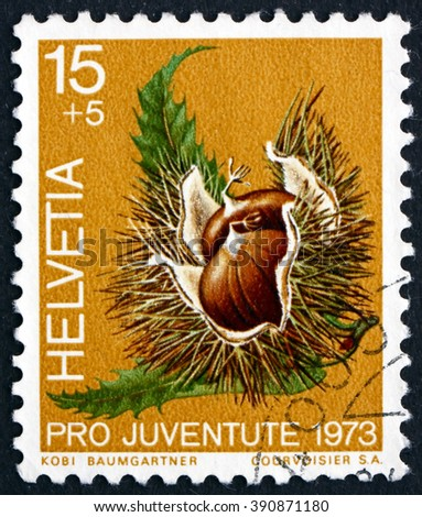 SWITZERLAND - CIRCA 1973: a stamp printed in the Switzerland shows Chestnut, Castanea Sativa, Fruit of the Forest, circa 1973 - stock photo