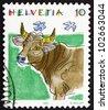 SWITZERLAND - CIRCA 1992: a stamp printed in the Switzerland shows Cow, Bos Taurus, Animal, circa 1992 - stock photo