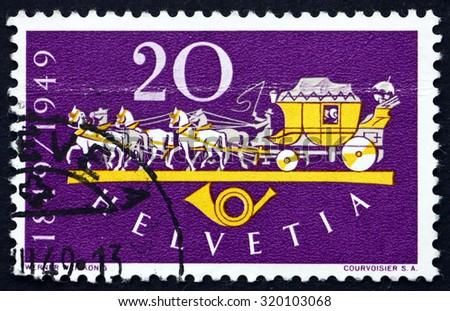 SWITZERLAND - CIRCA 1949: a stamp printed in the Switzerland shows Horse Drawn Mail Coach, Centenary of the Establishment of the Federal Post in Switzerland, circa 1949 - stock photo