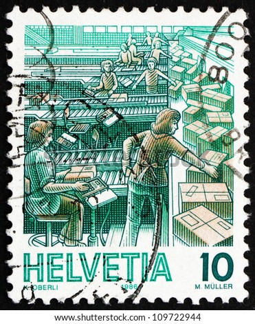 SWITZERLAND - CIRCA 1986: a stamp printed in the Switzerland shows Parcel Sorting, Mail Handling, circa 1986
