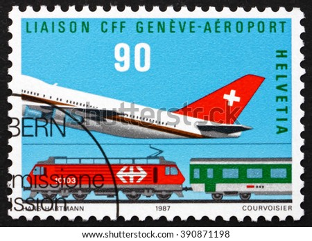 SWITZERLAND - CIRCA 1987: a stamp printed in the Switzerland shows Plane and Train, Cointrin Airport-Geneva, Rail Link Opening, circa 1987 - stock photo