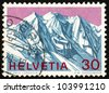 SWITZERLAND - CIRCA 1970: A stamp printed in the Switzerland shows View of Piz Palu, Grisons, Swiss Alps, circa 1970 - stock photo
