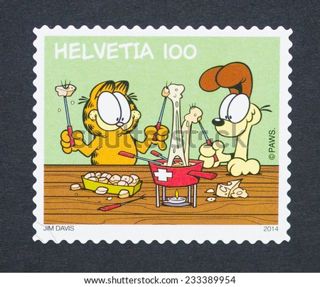 SWITZERLAND - CIRCA 2014: postage stamp printed in Switzerland showing an image of the cartoon characters the cat Garfield and the dog Odie, circa 2014.  - stock photo