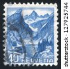 SWITZERLAND - CIRCA 1936: stamp printed by Switzerland, shows Alpine Lake of Santis, circa 1936 - stock photo