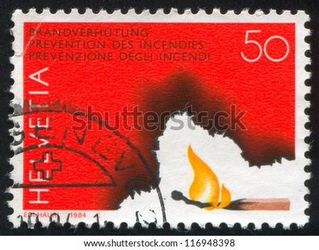 SWITZERLAND - CIRCA 1984: stamp printed by Switzerland, shows Burning Match, circa 1984 - stock photo