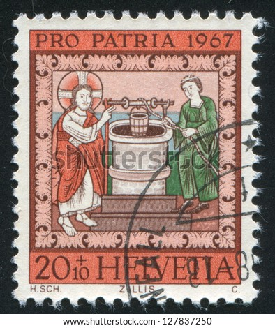 SWITZERLAND - CIRCA 1967: stamp printed by Switzerland, shows Jesus and the Samaritan Woman at the Well, circa 1967