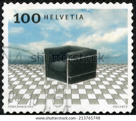 SWITZERLAND - CIRCA 2003: stamp printed by Switzerland, shows Le Fauteuil Grand Confort designed by Le Corbusier, circa 2003 - stock photo