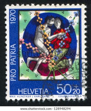 SWITZERLAND - CIRCA 1970: stamp printed by Switzerland, shows Man and woman by Max Hunziker and Karl Ganz, circa 1970 - stock photo