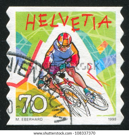 SWITZERLAND - CIRCA 1998: stamp printed by Switzerland, shows Mountain biking,  circa 1998