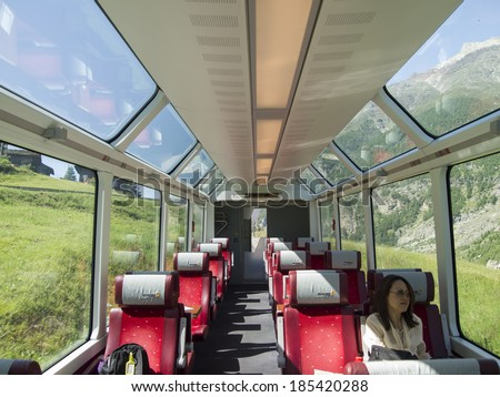 SWITZERLAND - JUN 28: Interior of Glacier Express train on June 28, 2011 in Switzerland. This train travels from Zermatt to Davos or St. Moritz. and being the slowest express train in the world. - stock photo