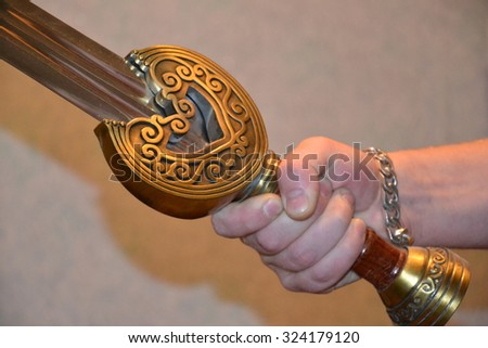 Sword at a hand. Fitting of the knightly weapon. - stock photo