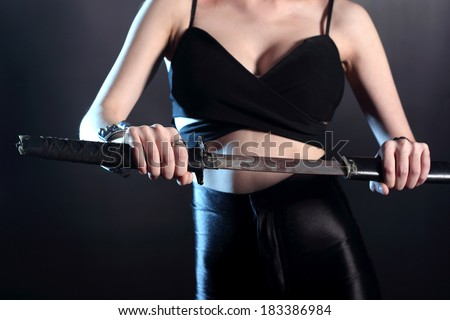 sword on hand sexy yakuza girl - stock photo