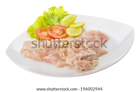 Swordfish carpaccio with lime and salad leaves