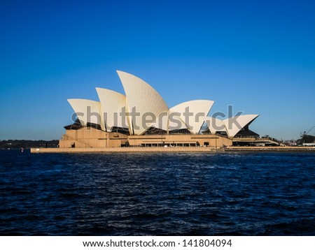 SYDNEY-APRIL 25:Sydney opera house  night view with full moon in Sydney,Australia on 25 April 2012 .It was designed by Danish architect Jorn Utzon. - stock photo