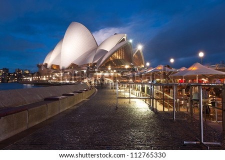 SYDNEY - APRIL 19: The Iconic Sydney Opera House is a multi-venue performing arts centre also containing bars and outdoor restaurants. April 19, 2012 in Sydney, Australia. - stock photo