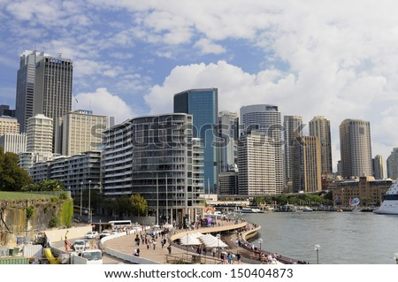 SYDNEY - APRIL 7: View of downtown Sydney, Australia on April 7, 2013 looking towards Circular Quay from the Opera House. People are walking along waterfront which is a popular tourist destination.