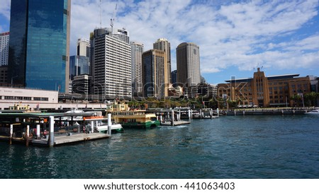 SYDNEY - AUG 22: Sydney city central business district view from harbour ferry over bay blue skyline on August 22, 2015. The city receives 7.5 million domestic overnight visitors every year.