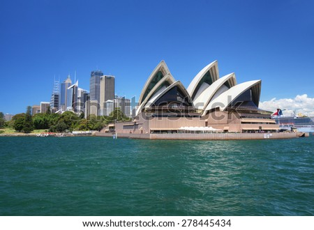 SYDNEY - AUG 10: The city of Sydney and the Opera House in New South Wales, Australia on January 7, 2015. The Opera house was designed by Danish architect Jorn Utzon. - stock photo