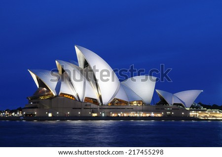 SYDNEY - August 22: The sails of the Sydney Opera House beam white at dusk on August 22, 2010 in Sydney, New South Wales, Australia. - stock photo